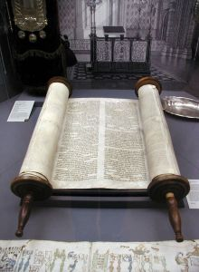 A photograph of an opened Torah scroll, housed at the Glockenglasse Synagogue